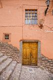 House in Cusco. Fragment of an old house in Cusco, Peru with door and two windows Royalty Free Stock Photo