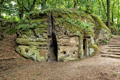House cut into the moss covered sand stone rock Royalty Free Stock Photo