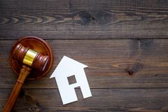 House cutout near judge gavel on dark wooden background top view copy space. Housing law. Property division. Real estate