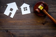 House cutout near judge gavel on dark wooden background top view copy space. Housing law. Property division. Real estate. Auction royalty free stock image