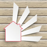 House Cutting Banners Wood. Paper house symbol on the wooden background Royalty Free Stock Image