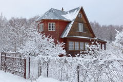 House (dacha) in countryside in winter. Russia. Royalty Free Stock Photo