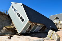 House damage following Hurricane Irma. House on side over cliff on beach following Hurricane Irma in North Beach, Florida stock photography