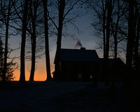 House at dawn. Silhouetted against the skyline Stock Photos