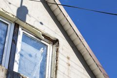 House with decaying facade. Blue sky stock images