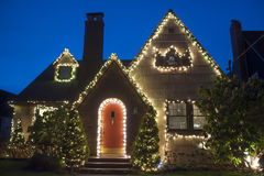 House decorated for Christmas. Suburban house decorated with lights for Christmas Stock Images
