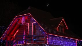 House decorated for Christmas. And moon -  Christmas celebration stock video