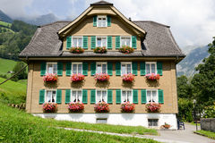 House decorated with flowers at Engelberg Royalty Free Stock Photography