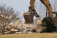 House demolition with an industrial excavator Royalty Free Stock Photo