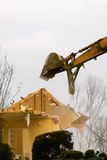 House demolition with an industrial excavator Stock Image