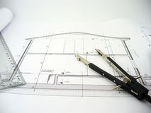 House design. Blueprint of a building with compass and part of a ruler Stock Image