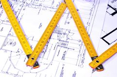 House design. House plans and folding rule Stock Images