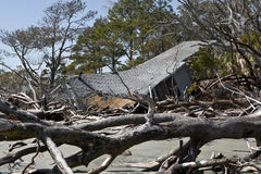 House destroyed by flood. Surrounded by driftwood stock photography