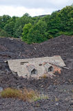 House destroyed by Lava. House covered with lava bed caused by Etna eruption stock photography
