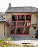 House is destroyed by a slow moving landslide Stock Photo