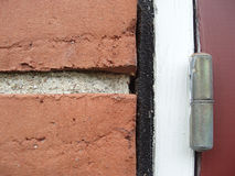 House detail. Close-up of detail of a brick wall and a hinge royalty free stock photos