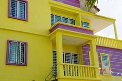 House Detail Yellow Siding. House exterior view of yellow siding and master bedroom window details Stock Photos