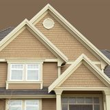 House Details. House siding details isolated on a beige background Royalty Free Stock Photos