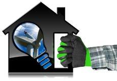 House di modello con il generatore eolico e la lampadina Fotografia Stock