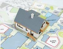 House di modello sui piani architettonici superiori - immagine di riserva Fotografia Stock