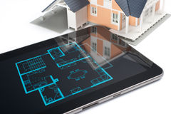 House and digital tablet Stock Photo