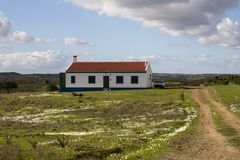 House and dirt road on the countryside Royalty Free Stock Images