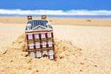 House disappearing in the sand. Royalty Free Stock Photos