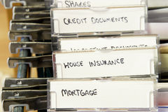 House documents. Detail of a filing cabinet with tabs labelled for mortgage documents, house insurance, etc Stock Image