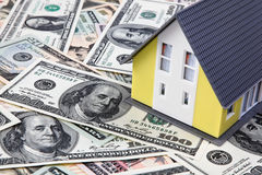 House on a dollar banknotes. A house stands on many dollars banknotes Royalty Free Stock Photo