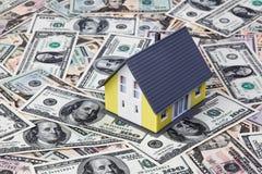 House on dollar bills Stock Photo