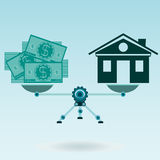 House and dollar bills on the scales in balance. Stock Photo