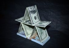 House of dollars on a black background royalty free stock images