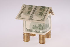 The house from dollars costs on coins Royalty Free Stock Photo