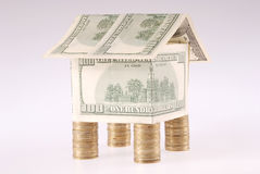 The house from dollars costs on coins Royalty Free Stock Photos