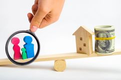 House, dollars and family on the scales. balance. buying, sellin royalty free stock images
