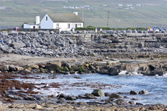 House on Doolin beach, county Clare, Ireland. Doolin`s Bay, The Burren, County Clare, Ireland royalty free stock photos