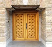 House door. Carved wooden door of a house Royalty Free Stock Image