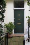 House door. Residential house doorway with green door and patio Royalty Free Stock Images