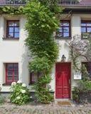 House door with flowers, Altenburg, Germany Stock Photo