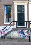 House Door and Grafitti in Amsterdam Stock Photography