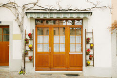 House door and huge flower jar Royalty Free Stock Images