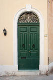 House door in Malta. House entrance door in Malta, painted in typical strong colors Stock Photo