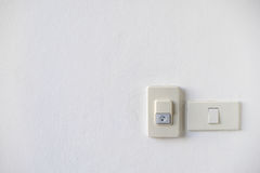 House Doorbell with light switch. On white wall in front of the house Royalty Free Stock Photos