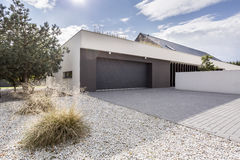 House with double garage. Modernly designed house with double garage stock photos