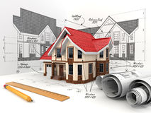 House on the drafts in different projections and blueprints. Royalty Free Stock Photo