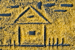 House drawing on an impressive surface of salt for Spa therapies. House. Stock Photo