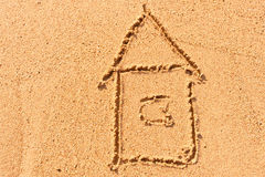 House drawing on the wet sand at the sea Royalty Free Stock Photography