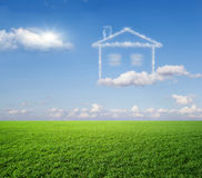 The house, a dream. Green grass and dream house from clouds Stock Images