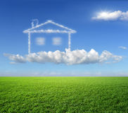 The house, a dream. Green grass and dream house from clouds royalty free stock photos