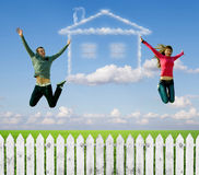 The house, a dream. Green grass and dream house from clouds Royalty Free Stock Photography